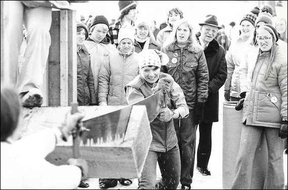 image: Barb Knight races to saw a piece of timber at Foresters Day in the 1970s.